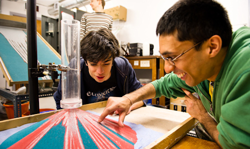 Two students with model of volcano