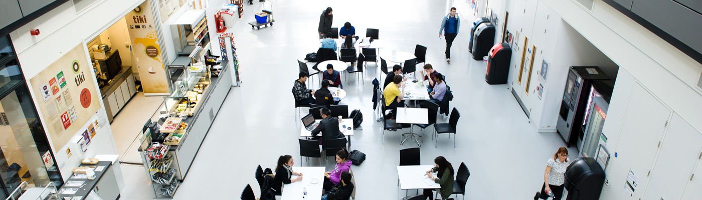 Aerial view of people sat in Alan Turing Building foyer