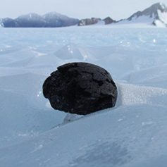 A meteorite resting on the ice in Antarctica